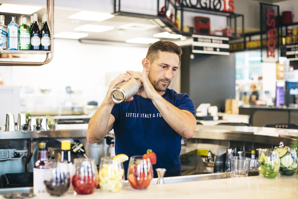 Photo of bartender using cocktail shaker