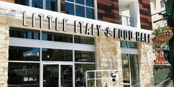 Exterior shot of Little Italy Food Hall on a sunny day